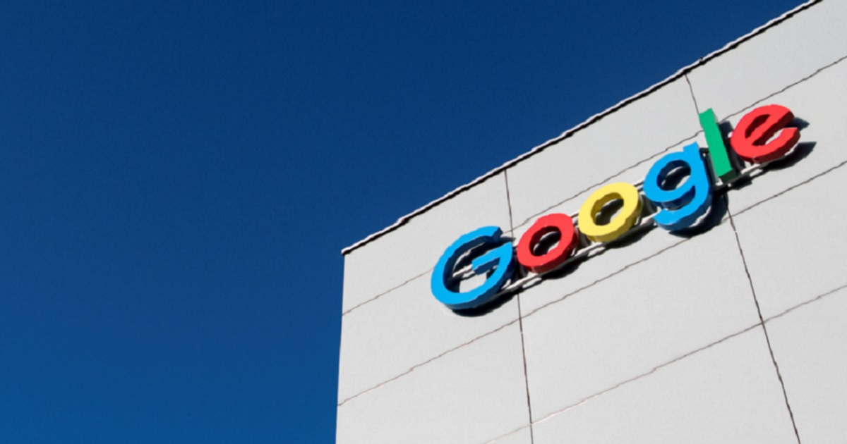 Building with Google sign against deep blue sky.