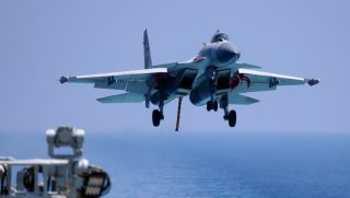 This photo taken on April 14, 2018 shows a J15 fighter jet preparing to land on China's sole operational aircraft carrier, the Liaoning, during a drill at sea.