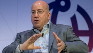 Jeff Zucker seated on a stage