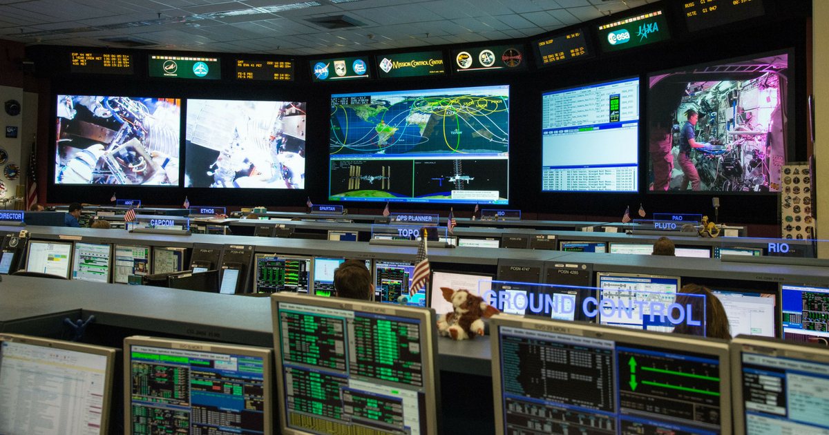 Flight controllers in the International Space Station Mission Control at the Johnson Space Center monitor systems aboard the orbiting laboratory during a number of dynamic events for Expedition 44 on Aug. 10, 2015.