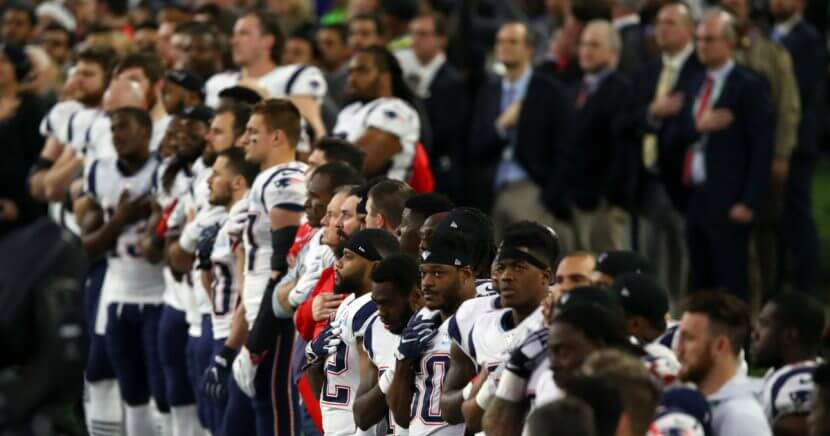 The New England Patriots stand during the national anthem prior to Super Bowl LII against the Philadelphia Eagles at U.S. Bank Stadium on Feb. 4 in Minneapolis.