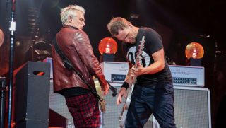 Lead guitarist Mike McCready (L) and bassist Jeff Ament of Pearl Jam perform live on stage