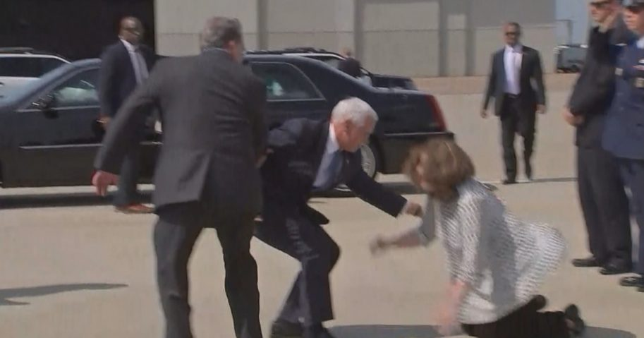 Mike Pence rushes to help a Congressman's wife up.