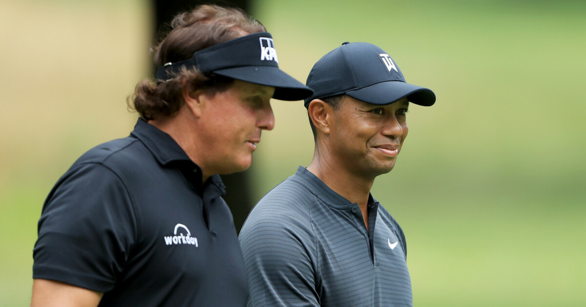 Phil Mickelson (L) and Tiger Woods meet during a preview day of the World Golf Championships - Bridgestone Invitational at Firestone Country Club South Course at on Aug. 1, 2018 in Akron, Ohio.