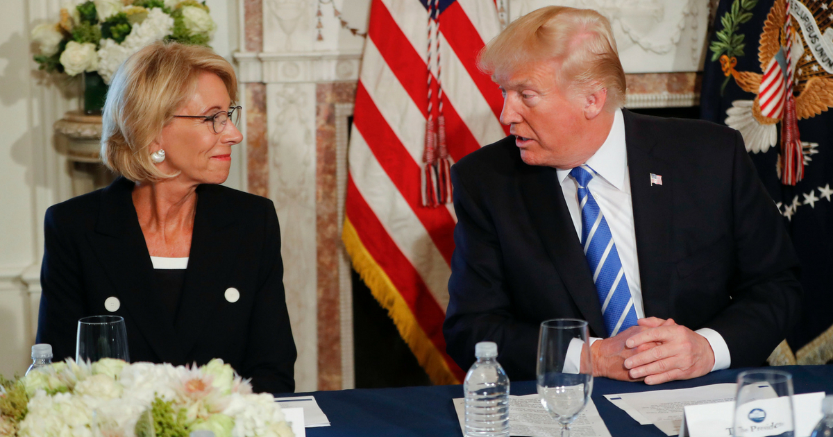 President Donald Trump looks toward Education Secretary Betsy DeVos, as he speaks during a workforce/apprenticeship discussion at Trump National Golf Club in Bedminster, N.J., Friday, Aug. 11, 2017.