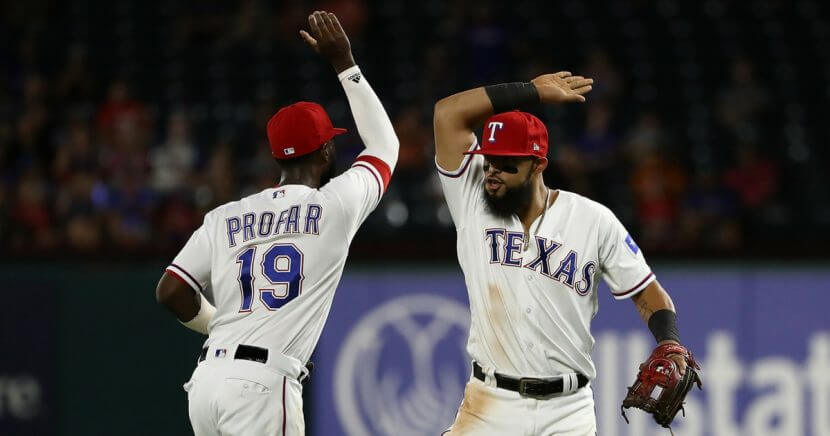 Jurickson Profar, left, and Rougned Odor of the Texas Rangers celebrate a triple play against the Los Angeles Angels in the fourth inning at Globe Life Park in Arlington on Aug. 16 in Arlington, Texas.
