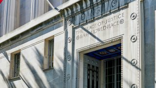"Robert F Kennedy Department of Justice building entrance ""The Place of Justice is a Hallowed Place"" engraved in stone above the door"