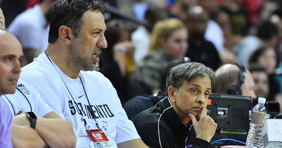 Vlade Divac, left, general manager of the Sacramento Kings, and team owner Vivek Ranadive watch a game between the Kings and the Memphis Grizzlies during the 2018 NBA Summer League.