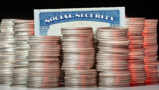 Many stacks of old silver dimes with social security card.
