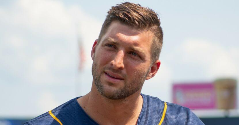 Tim Tebow of the Eastern Division All-Stars answers questions from the media before the 2018 Eastern League All Star Game at Arm & Hammer Park on July 11 in Trenton, New Jersey.