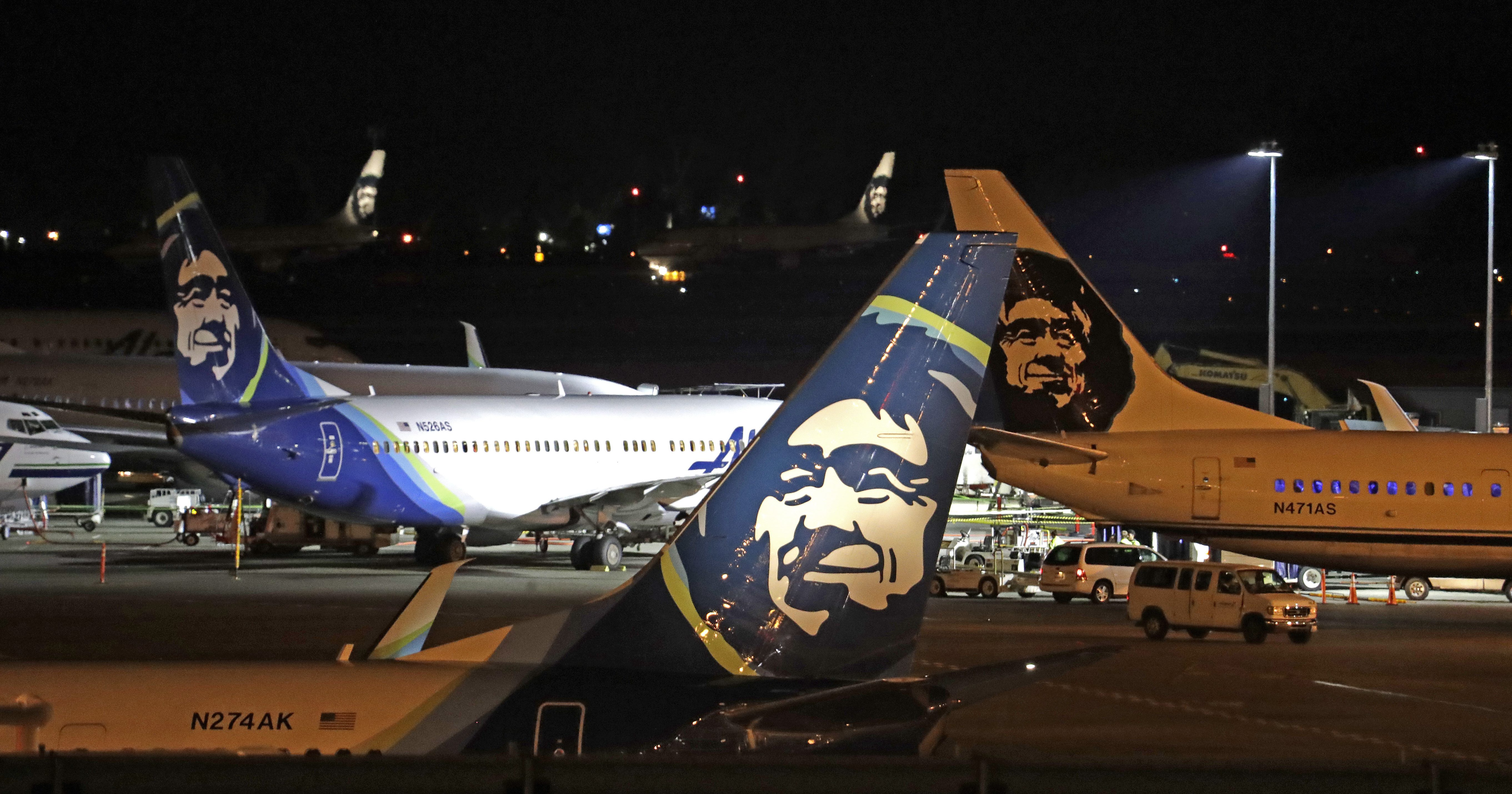 Alaska Airlines planes sit on the tarmac at Sea-Tac International Airport Friday evening, Aug. 10, 2018, in SeaTac, Wash.