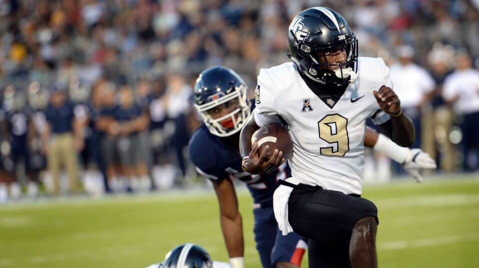 Central Florida running back Adrian Killins Jr. (9) runs the ball in for a touchdown during the first half of an NCAA college football game against Connecticut on Thursday in East Hartford, Conn.