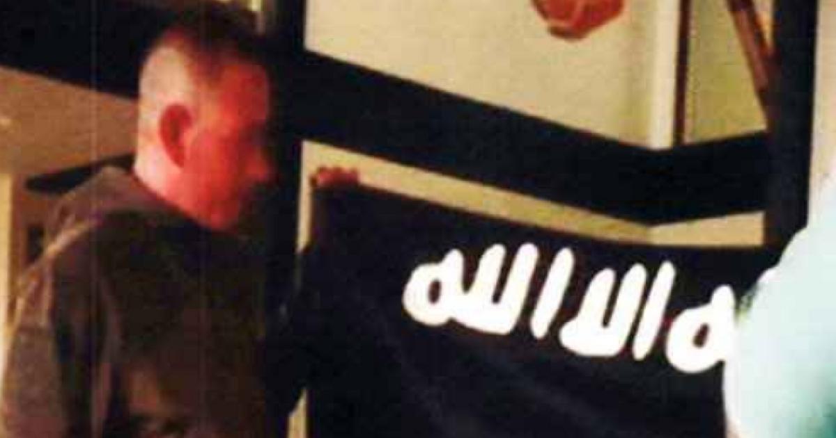 U.S. Army sergeant Ikaika Erik Kang with ISIS flag