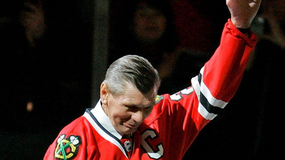 In this March 7, 2008, file photo, Chicago Blackhawks great Stan Mikita waves to fans as they as he is introduced before an NHL hockey game against the San Jose Sharks in Chicago. Mikita, who played for the Blackhawks for 22 seasons, becoming one of the franchise's most revered figures, has died, the Blackhawks announced Tuesday, Aug. 7, 2018. He was 78.