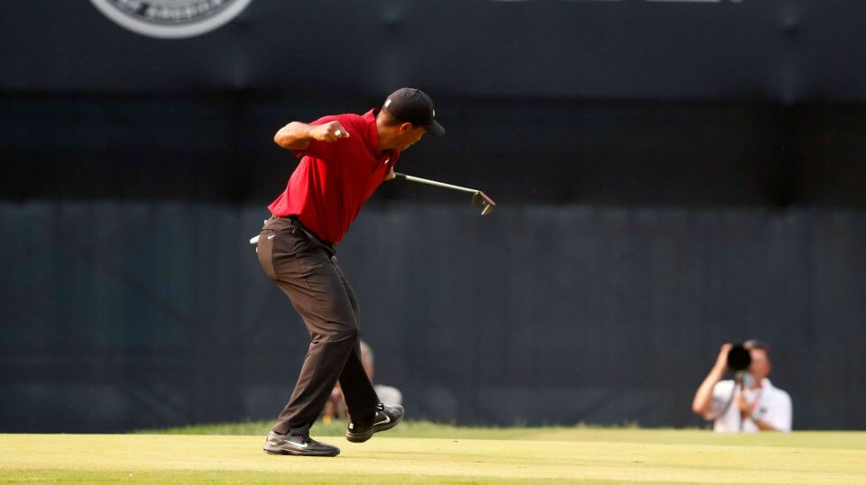 Tiger Woods celebrates his birdie putt on the 18th green during the final round of the 2018 PGA Championship