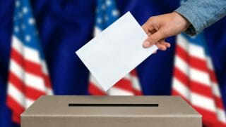 ballot box with a vote being held above it