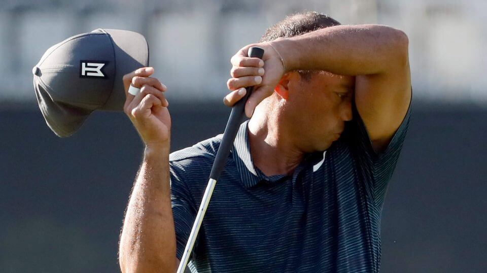 Tiger Woods wipes off his face on the10th green during the first round of the PGA Championship golf tournament at Bellerive Country Club, Thursday, Aug. 9, 2018, in St. Louis.