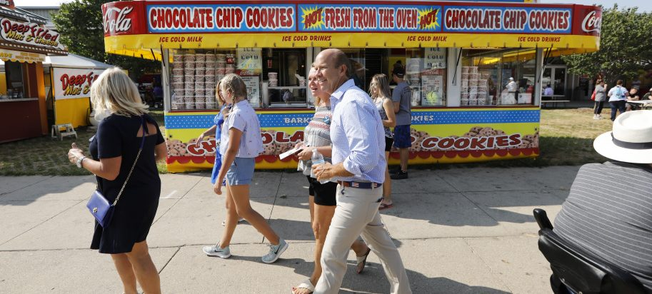 Rep. John Delaney, D-Md., walks past a concession stand during a visit to the Iowa State Fair, Friday, Aug. 10, 2018, in Des Moines, Iowa.
