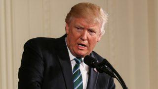 President Donald Trump speaking at podium