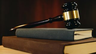 Gavel resting on a stack of books