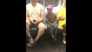A woman in a New York City subway decided to start filming a little boy peeking over a man's shoulder, and she captured gold.