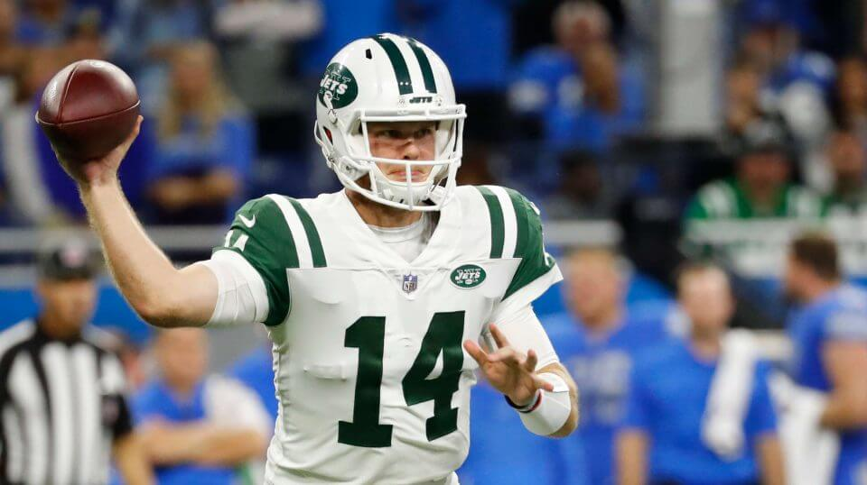 Jets rookie quarterback Sam Darnold throws a pass against the Lions in the first half of New York's season opener Monday night in Detroit.