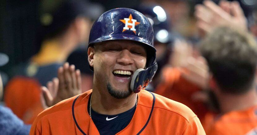 The Astros' Yuli Gurriel celebrates in the dugout after hitting a grand slam against the Los Angeles Angels during the first inning Friday in Houston.
