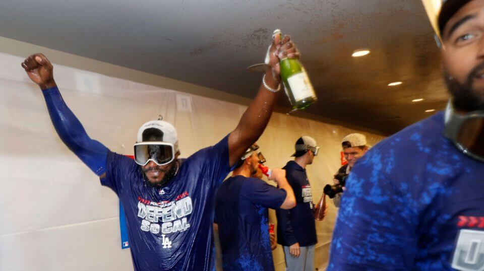 The Los Angeles Dodgers' Yasiel Puig celebrates clinching a playoff spot after beating the San Francisco Giants on Saturday.