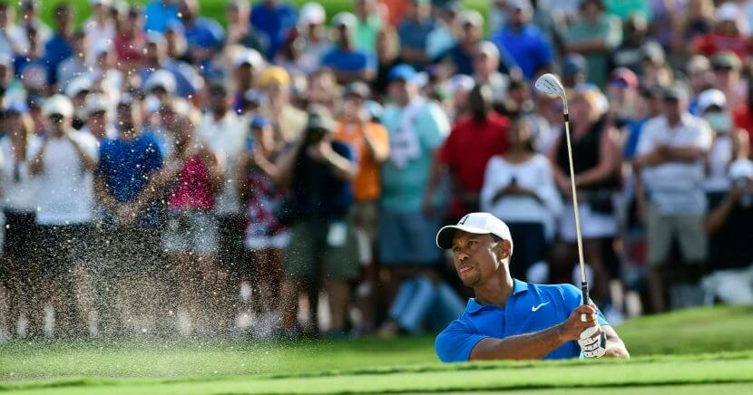 Tiger Woods hits out of the sand to the 15th green during the third round of the Tour Championship golf tournament Saturday in Atlanta.