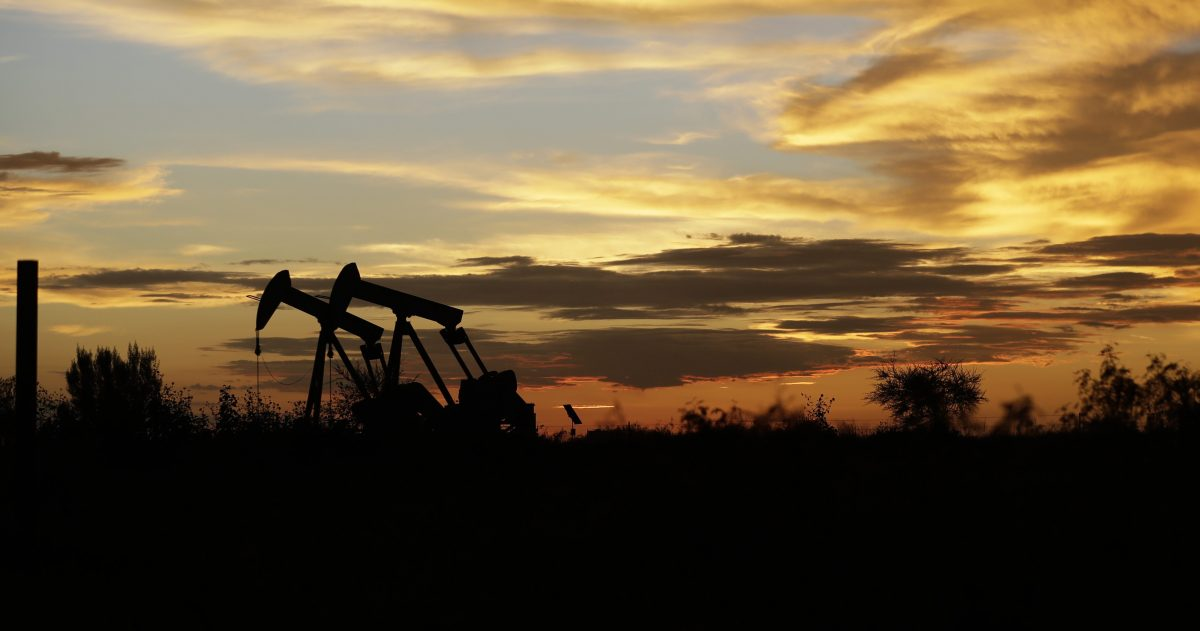 In this June 5, 2017, file photom pumpjacks work in an oil field at sunset after a thunderstorm passed through the area in Karnes City, Texas.