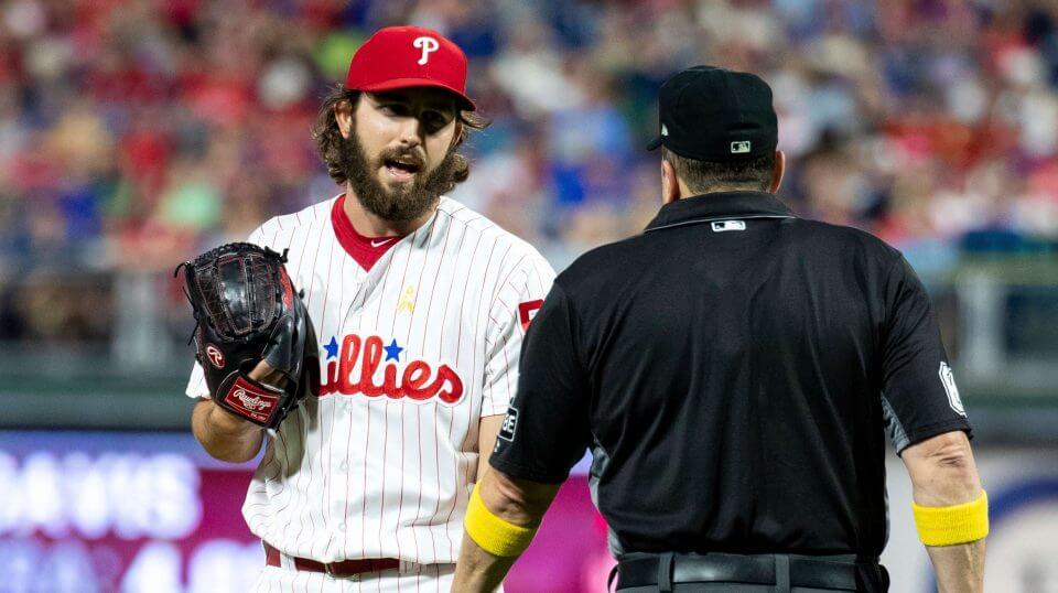 Philadelphia Phillies relief pitcher Austin Davis, left, talks with umpire Marty Foster, right, during the eighth inning Saturday against the Chicago Cubs in Philadelphia