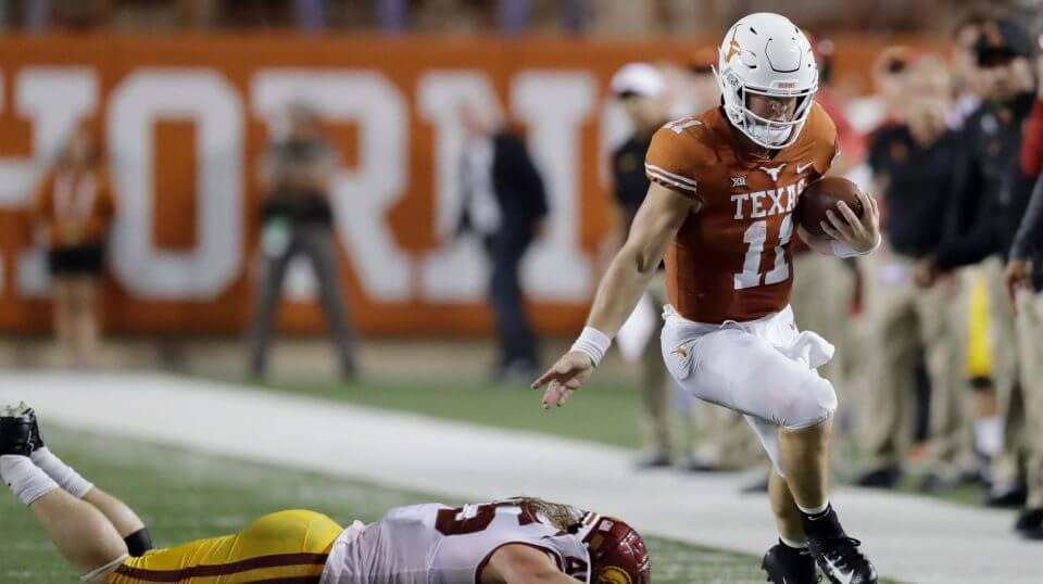 Texas quarterback Sam Ehlinger (11) works to stay in bounds as he runs past Southern California linebacker Porter Gustin (45) Saturday in Austin, Texas.