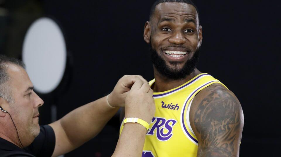 Los Angeles Lakers star LeBron James smiles as a microphone is placed on his chest during media day Monday at the NBA team's practice facility in El Segundo, California.