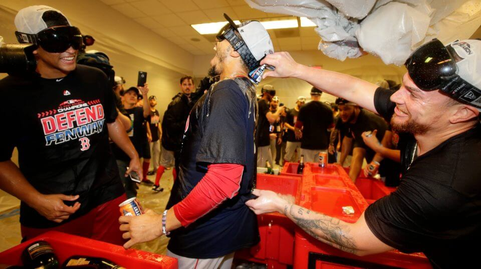 The Boston Red Sox's Mookie Betts, center, celebrates with teammates after they clinched the AL East title on Thursday in New York.