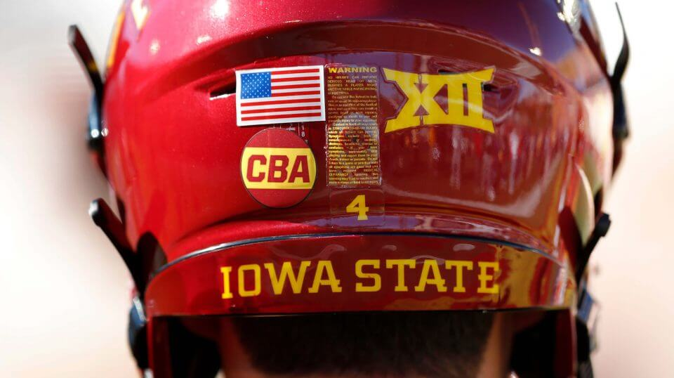 """Iowa State quarterback Zeb Noland wears a """"CBA"""" sticker on his helmet to honor slain student Celia Barquin Arozamena before a game against Akron, Saturday in Ames. Barquin, who was the 2018 Big 12 women's golf champion and Iowa State Female Athlete of the Year, was found Monday morning in a pond at a golf course near the Iowa State campus."""