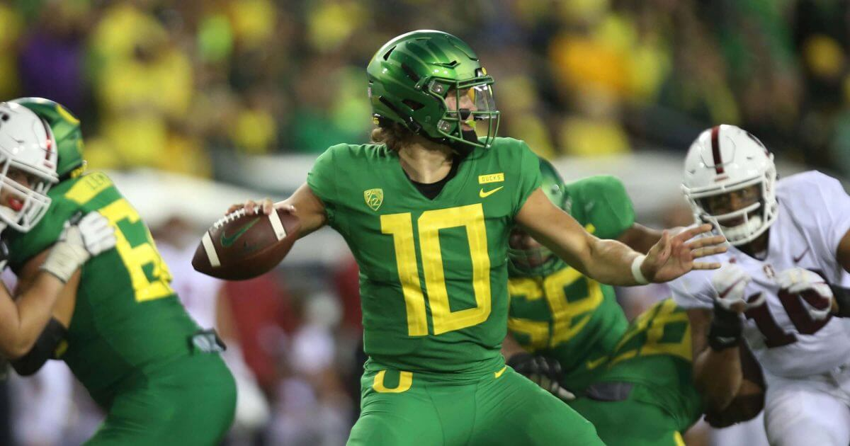 Oregon's Justin Herbert drops back to pass against Stanford Saturday in Eugene, Oregon.