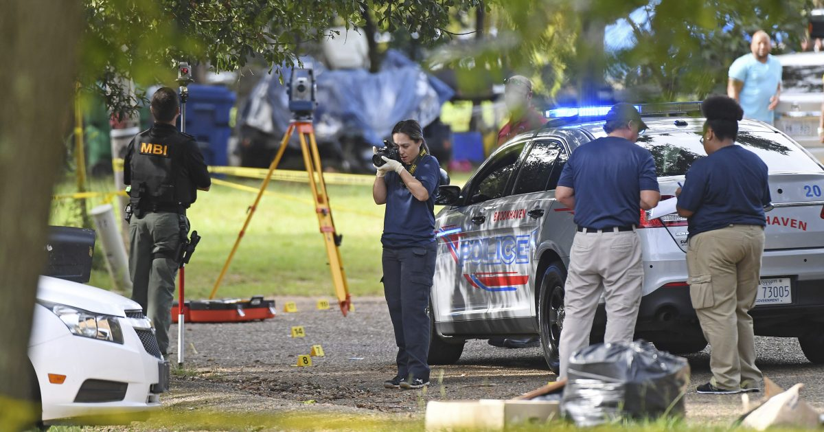 Mississippi Bureau of Investigations officers photograph the scene where two Brookhaven Police Officers were shot and killed in Brookhaven, Miss., Saturday, Sept. 29, 2018.