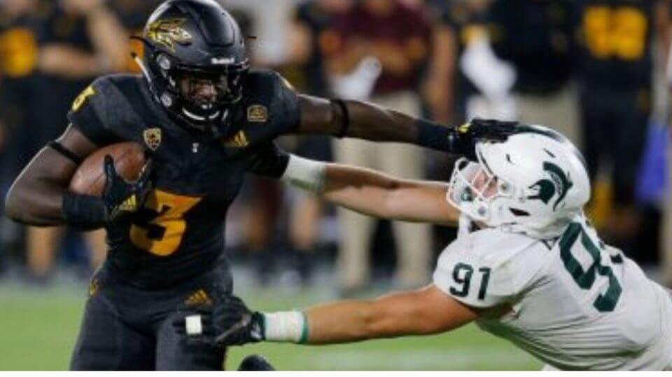 Arizona State running back Eno Benjamin (3) gives Michigan State defensive end Jack Camper (91) a stiff arm as he tries to get past during the second half of their game Saturday, Sept. 8, 2018, in Tempe, Ariz.