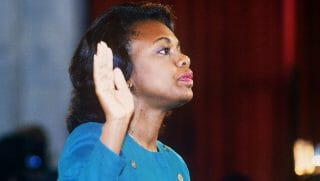 Anita Hill is sworn in before the Senate Judiciary Committee in Washington on Oct. 12, 1991.