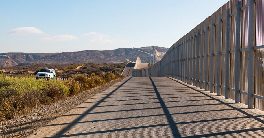 A U.S, Border Patrol vehicle cruises along the border between San Diego, California, and Tijuana, Mexico.