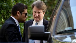 Brett Kavanaugh getting into an SUV.