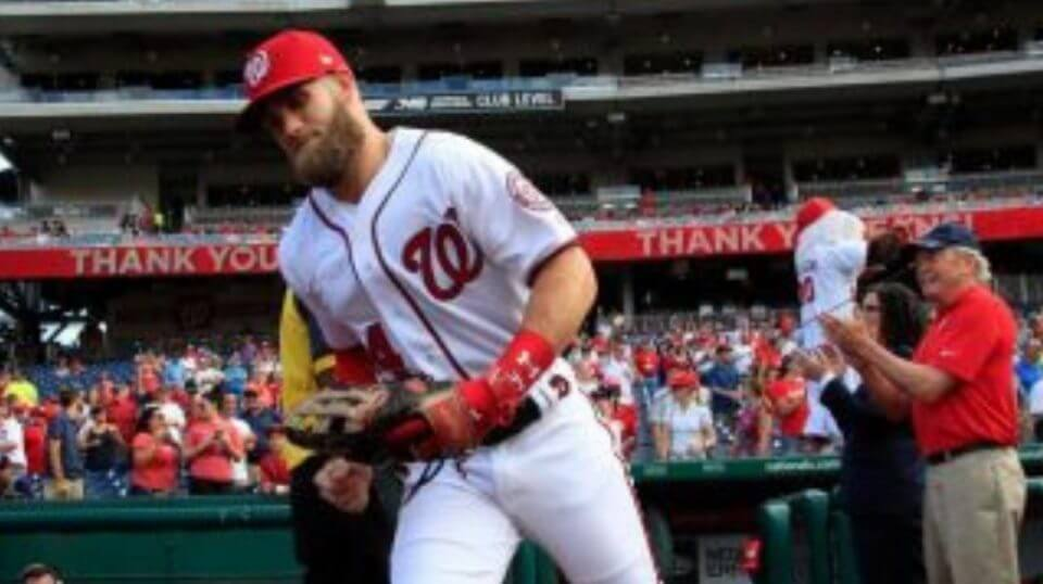 Washington Nationals right fielder Bryce Harper emerges from the dugout prior to the Nationals' last home game of the season Wednesday.