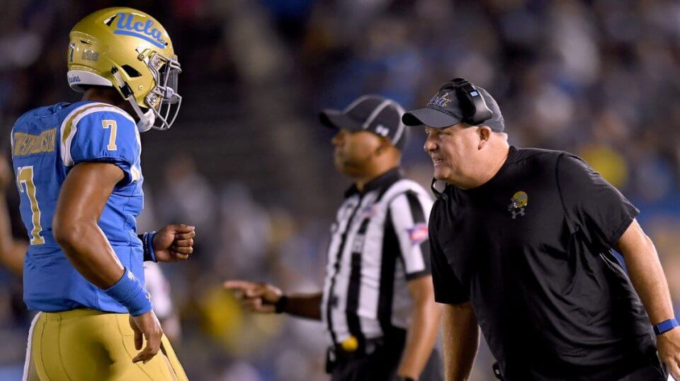 UCLA coach Chip Kelly talks with quarterback Dorian Thompson-Robinson during the second quarter of their game against the Fresno State Bulldogs at the Rose Bowl on Saturday.
