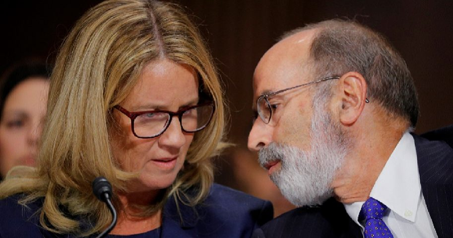 Christine Blasey Ford gets advice Thursday from Michael Bromwich, one of her attorneys, while appearing before the Senate Judiciary Committee.