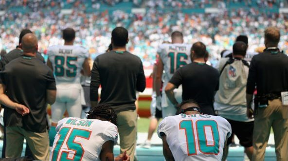 Miami Dolphins receivers Kenny Stills and Albert Wilson of kneel during the national anthem before their game against the Tennessee Titans at Hard Rock Stadium on Sept. 9.