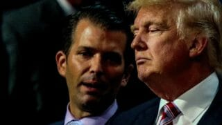 Donald Trump Jr. shares a private word with his father during the Republican National Convention in July 2016.