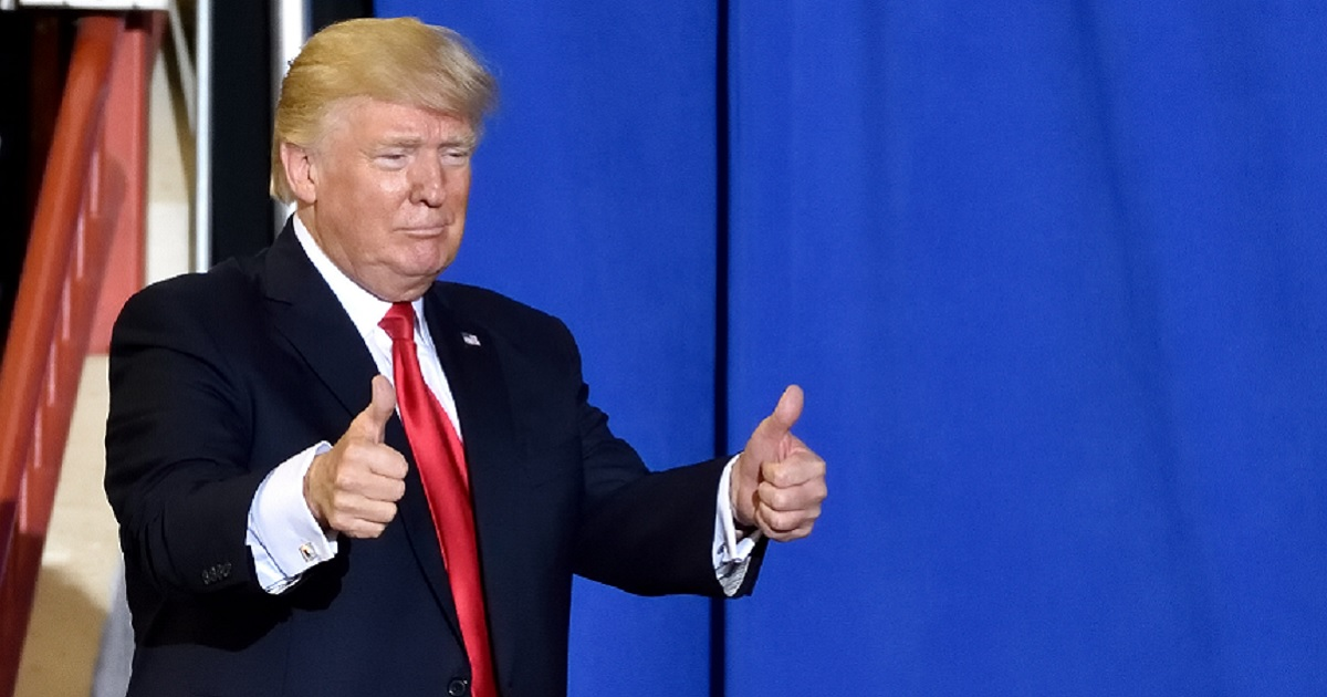 President Trump gives two thumbs up to his audience before a speech.