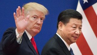 President Donald Trump, left, and China's President Xi Jinping at the Great Hall of the People in Beijing in November. (Nicolas Asfouri / AFP / Getty Images)