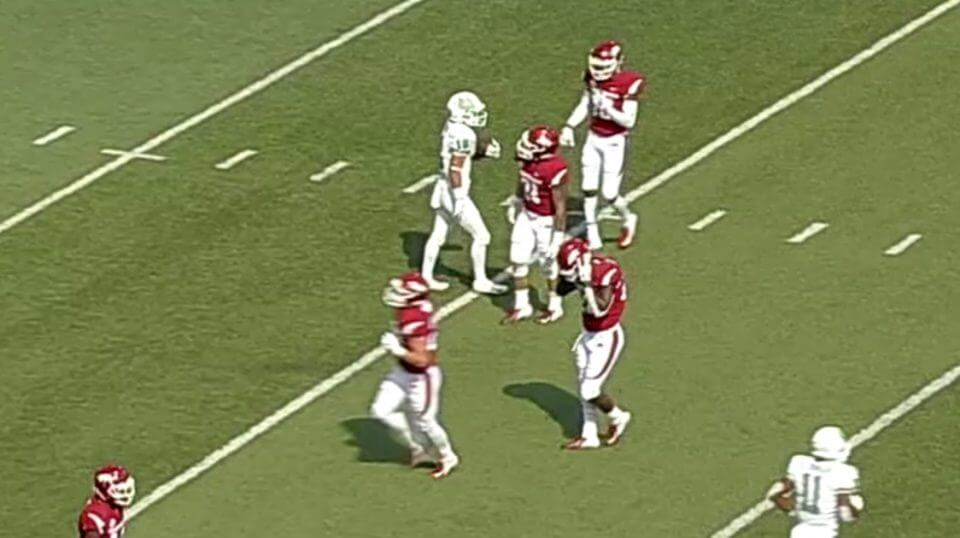 University of Arkansas players (in red) walk away from North Texas return specialist assuming he made a fair catch. Instead, he took off running for a 90-yard touchdown.