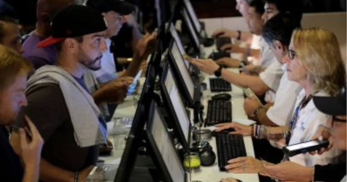 FanDuel customers place bets at the Meadowlands Racetrack in East Rutherford, New Jersey, in July.